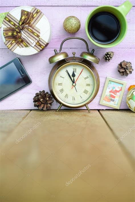how many copies of a cup of christmas tea sold picture of coffee cup alarm clock and decorations on wooden background copy space