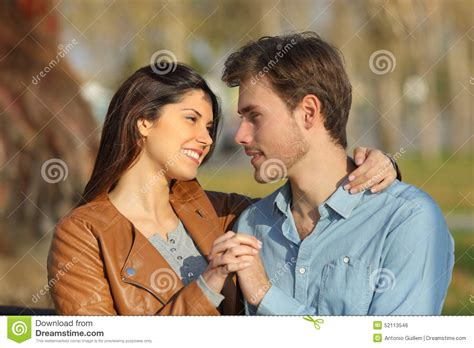 Looking For On The Dating by Hugging And Dating In A Park Looking Each Other