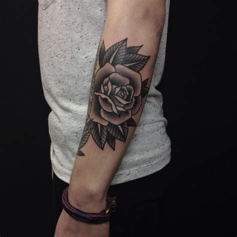 rose tattoo on elbow meaning 1000 ideas about black tattoos on