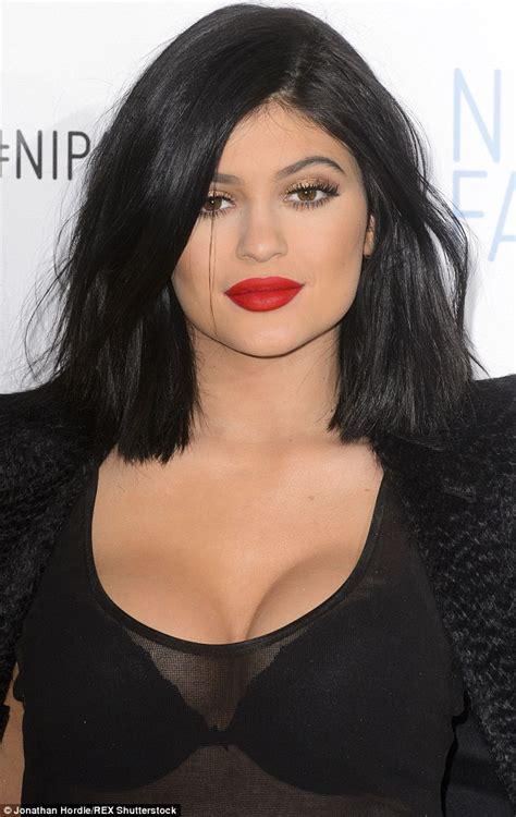 kim kardashian shot glass lips kylie jenner and tyga pair up for la outing after blac