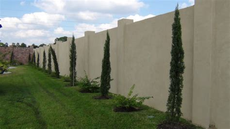 Stucco Walls Mediterranean Landscape houston by Theme Designs