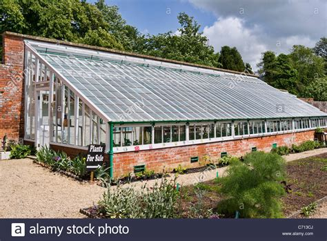 walled gardens for sale large glass house in a walled garden in wiltshire uk stock