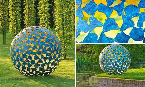 smartly designed modern spherical garden sculptures