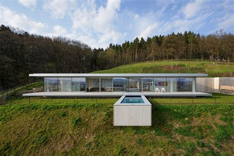 houses on hills pool that seems to float above a hill zero energy