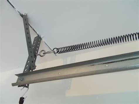 How To Install Garage Door Springs Overhead Replace A Broken Garage Door