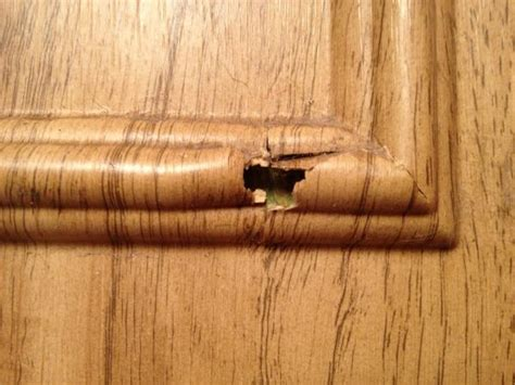fixing kitchen cabinets how to fix holes in veneer on kitchen cabinets