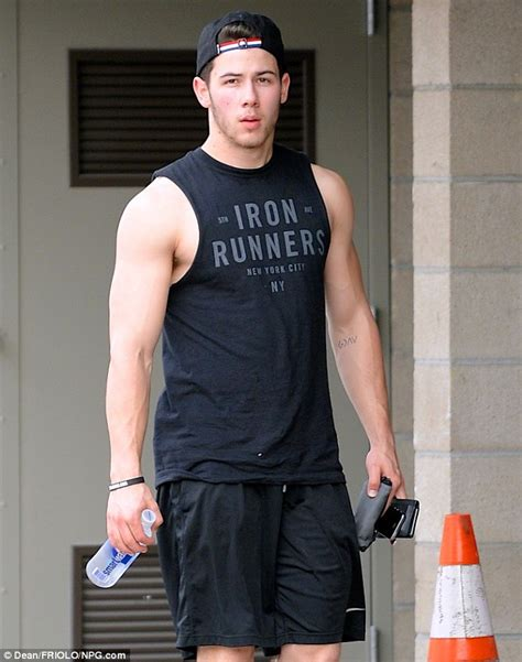 nick jonas shows off biceps in tank top after gym session