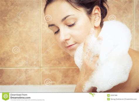 women in bathtub woman in bathtub full of foam royalty free stock photos