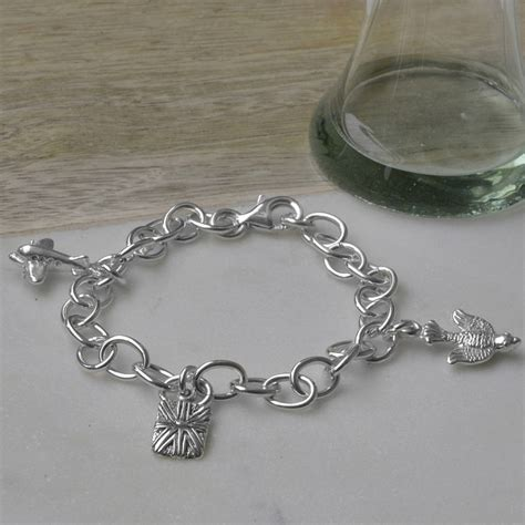 personalised sterling silver travel charm bracelet by