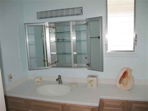 modern white stained wooden bathroom cabinet with glass