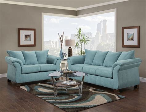 blue two living room set with rug for