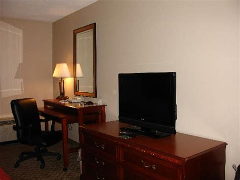 desk and tv stand picture of inn hotel suites