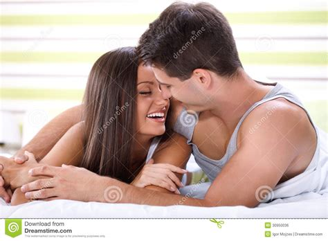 images of love couple kissing in bed kissing couple in bed royalty free stock image image