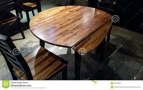fold down round round wooden table with wood details stock photo image