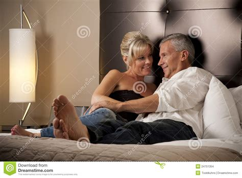 man and woman in bed man and woman relaxing in a hotel room bed stock images image 24751354