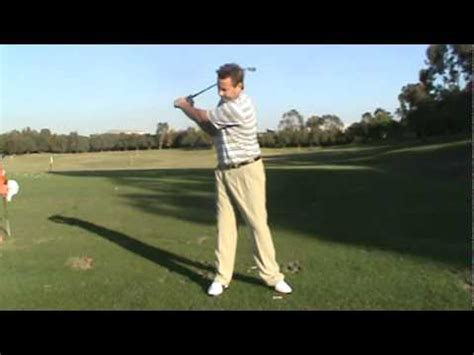 swing the handle golf the golfing machine hitting vs swinging doovi