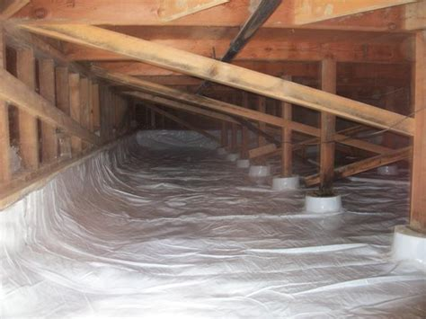 vapor barrier under house crawl space clean up moisture barrier sump pumps general contractor