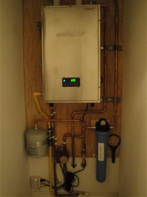 Bowers Plumbing by Heater Treater Filter And Expansion Tank Installed On