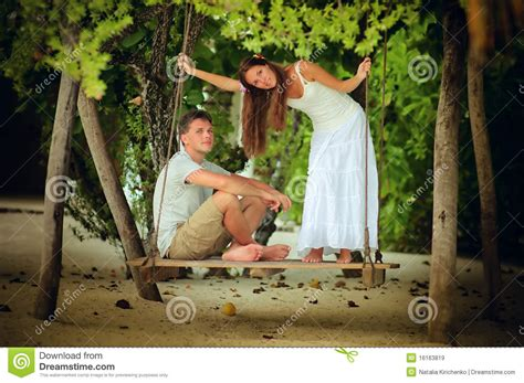 young swinging couple young romantic couple swinging royalty free stock images