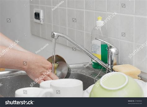 washing dishes in bathroom sink washing dishes kitchen basin stock photo 27489064