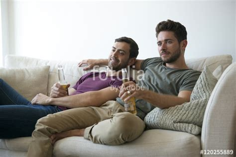gay on the couch quot gay male couple on sofa at home watching tv drinking beer