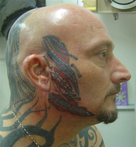 biomechanical tattoo face colored biomechanical tattoo on face