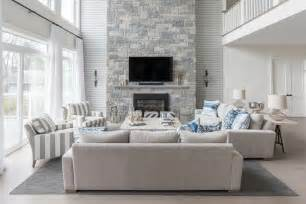 Living room with a two story stone fireplace transitional living