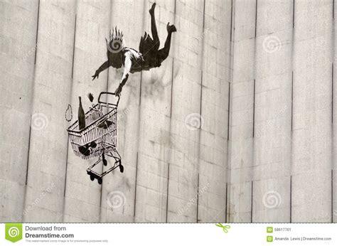 banksy falling shopper graffiti london editorial photo