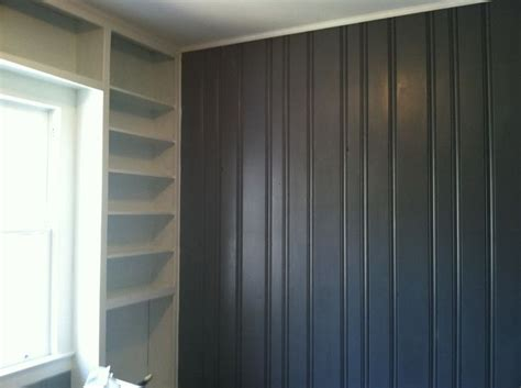 painted wood paneling grey and white shelving turned