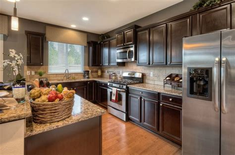 dr horton kitchen cabinets dark light woods used together in this kitchen creates a