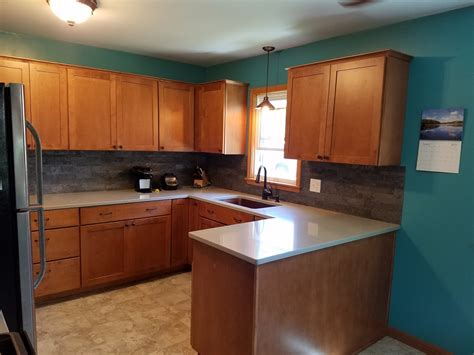 pictures of kitchens with maple cabinets kitchen remodel with maple cabinets and hanstone quartz