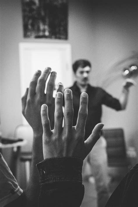Person Grayscale Photography Of Two People Raising Their