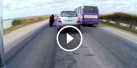 bike riders challenge death  overtaking cars