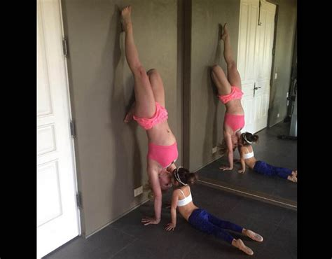 is britney spears ready to stand on her own the new britney spears does a hand stand against the wall and
