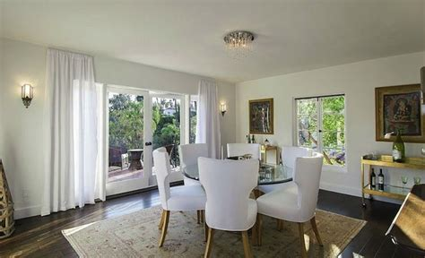 statement lighting for the white dining room white dining chairs mediterranean dining room