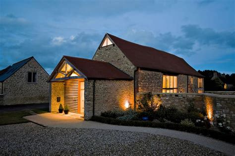 barn converted to the contemporary house with a pool contemporary conversion of an old stone barn by the