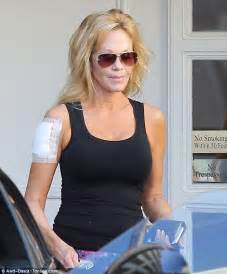 melanie griffith heads to the gym before getting another