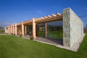 House tabasek stone glass and wood house by qarta architektura