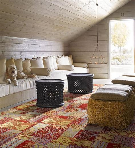 Features a barn board ceiling and walls lined with a built in bench