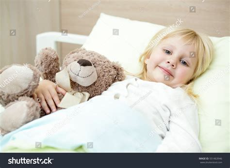 cozy and comfortable comfortable cozy adorable little girl resting stock photo