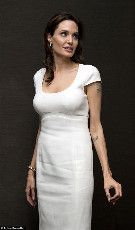angelina jolie dons two white in one day as she