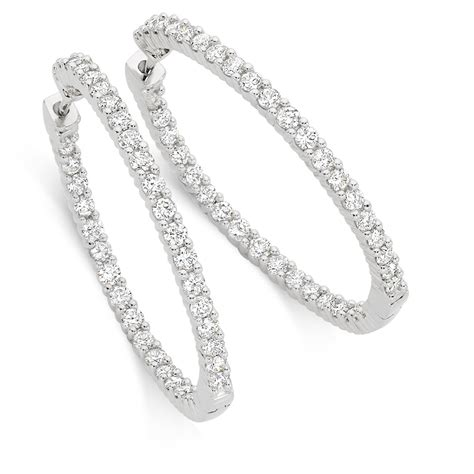 Hoop Earrings With hoop earrings with 2 carat tw of diamonds in 18kt white gold