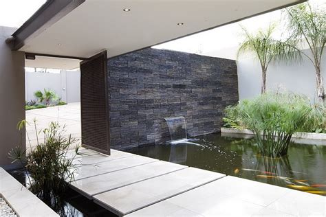 modern water feature water feature at the entrance of the house decoist