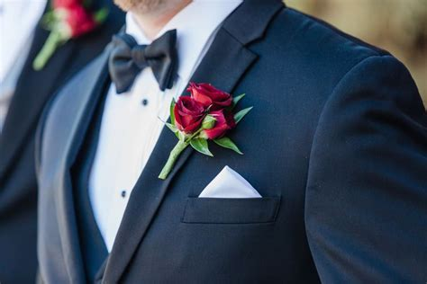 classic red rose boutonniere   lapel   black tux