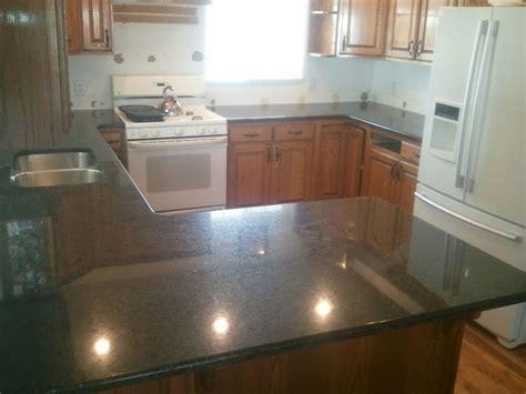 Oak Corbels For Granite Countertops by Solutions Granite Granite Countertops With Corbels