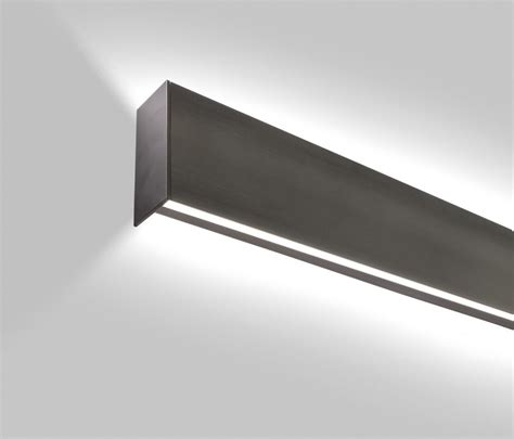 vertical fixtures or sconces mounted on either side of the lp grazer designed with a minimal profile for vertical