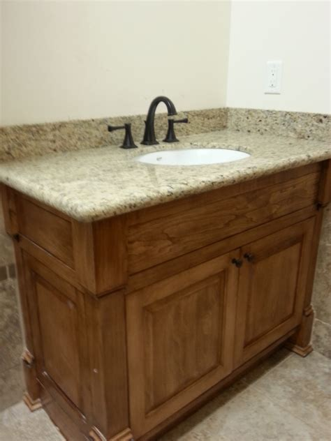 solid wood bathroom vanity with marble countertop delta