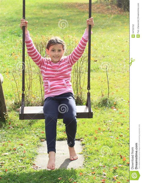 kid on swing kid girl on swing stock photography image 34750752