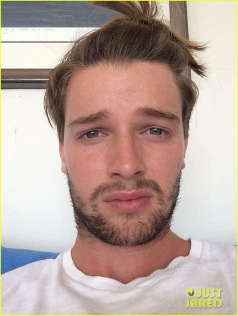patrick schwarzenegger strips down for shark week fun