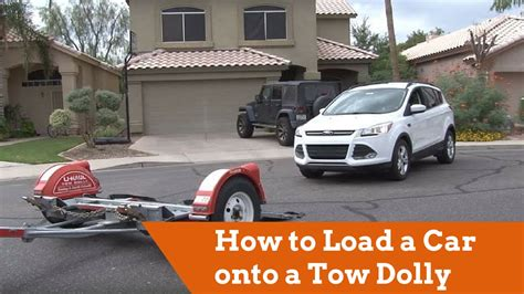 how to load a car onto a u haul tow dolly